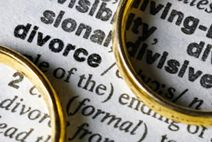 A photo of two wedding rings over the word divorce